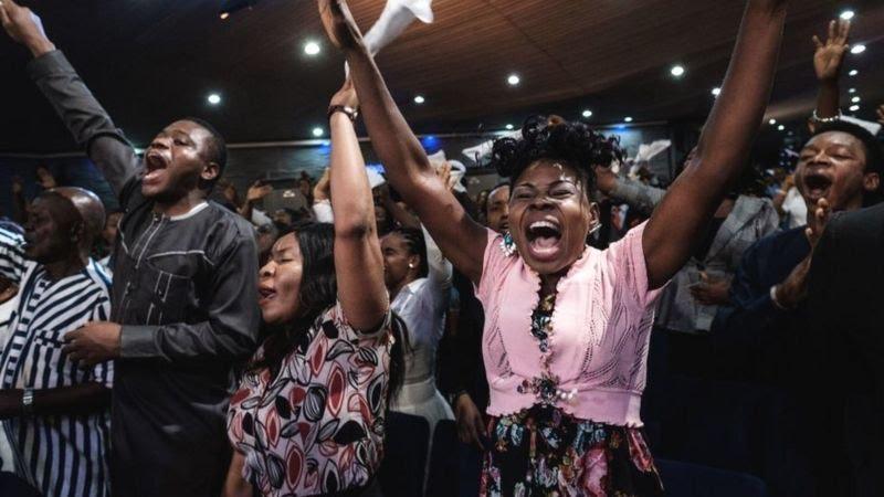 Christians brethren holding prayers at their worship place.