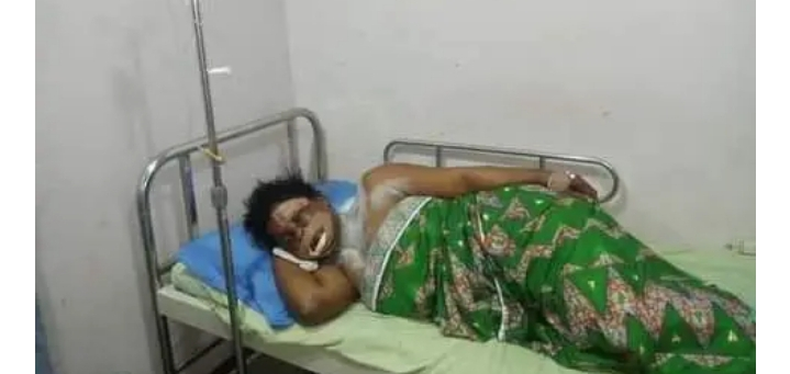 Mrs. Oke Ereeganoma, receiving treatment at a hospital in Delta State, after escaping a ritual attempt on her by his son.