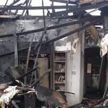 Burnt houses in Izombe, Imo State.